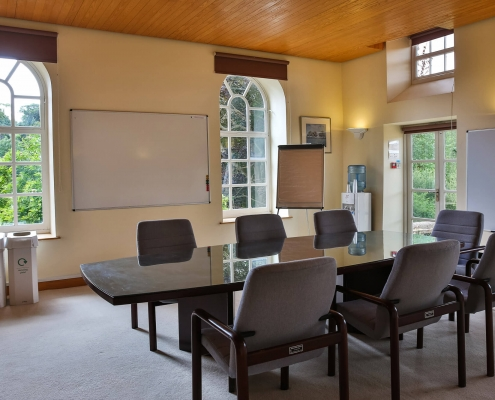 Oakroom Boardroom set for conference or meeting