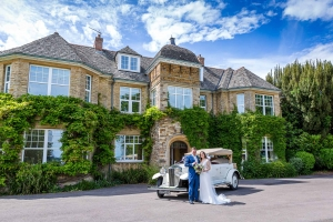 The Happy Couple with their Wedding car outside Middle Aston House Oxfordshire